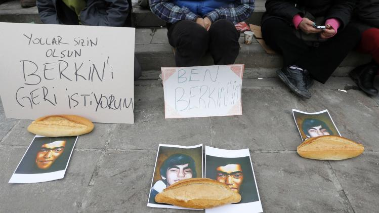 People attend a sit-in demonstration after the death of Berkin Elvan as his portraits lay on the ground beside breads in Ankara