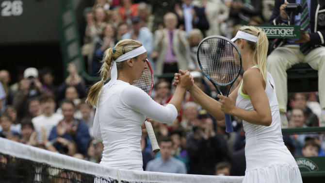 Maria Sharapova of Russia, right, congratulates Sabine Lisicki of Germany after she won a fourth round singles match at the All England Lawn Tennis Championships at Wimbledon, England, Monday, July 2, 2012. (AP Photo/Sang Tan)