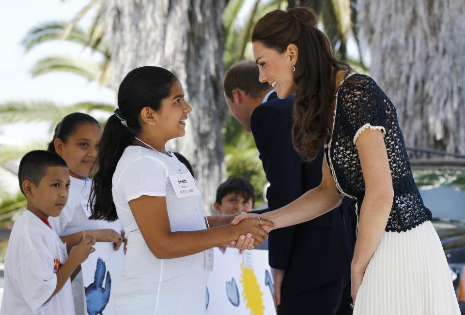 Prince William and Kate, the Duke and Duchess of Cambridge, greet students as they arrive at Inner-City Arts during their royal tour of California in Los Angeles, Sunday, July 10, 2011. (AP Photo/Matt Sayles)
