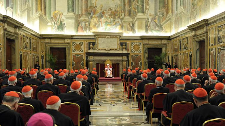 "In this photo provided by the Vatican newspaper L'Osservatore Romano, Pope Benedict XVI delivers his message on the occasion of his farewell meeting to cardinals, at the Vatican, Thursday, Feb. 28, 2013. Benedict XVI promised his ""unconditional reverence and obedience"" to his successor in his final words to his cardinals Thursday, a poignant farewell before he becomes the first pope in 600 years to resign. (AP Photo/L'Osservatore Romano, ho)"