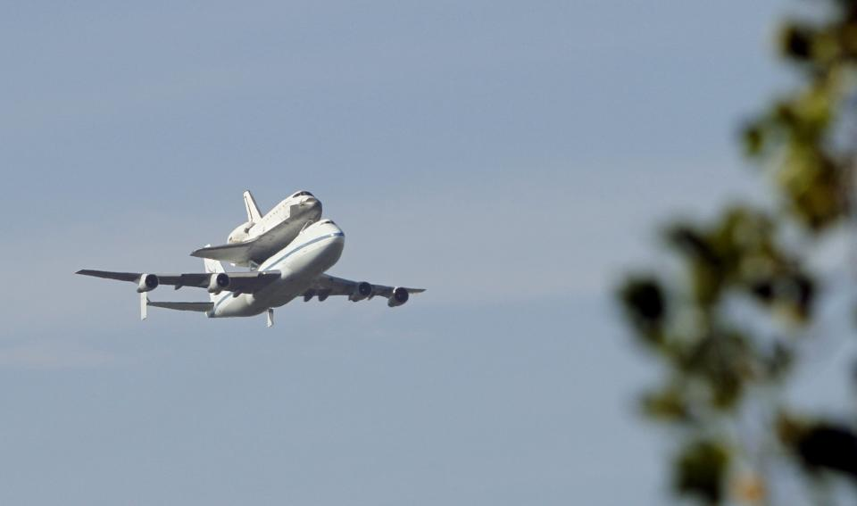 The space shuttle Endeavour passes over Sacramento, Calif., Friday, Sept. 21, 2012.  Endeavour is making a final trek across the country to the California Science Center in Los Angeles, where it will be permanently displayed.(AP Photo/Rich Pedroncelli)