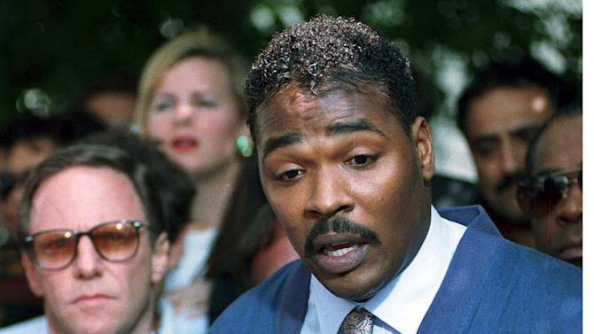 FILE - This May 1,1992 file photo shows Rodney King, right, accompanied by his attorney Steven Lerman, making his first statement, pleading for an end to the rioting in South Central Los Angeles, in Los Angeles. The St. Louis suburb of Ferguson, Missouri, was roiled by racial unrest after 18-year-old Michael Brown, who was black, was shot and killed by Darren Wilson, a white police officer, on Aug. 9. The street clashes there mirrored past, larger-scale riots in multiple US cities, most of them triggered by perceived racial injustice, or an incident involving police, in already tense communities. (AP Photo/David Longstreath, File)
