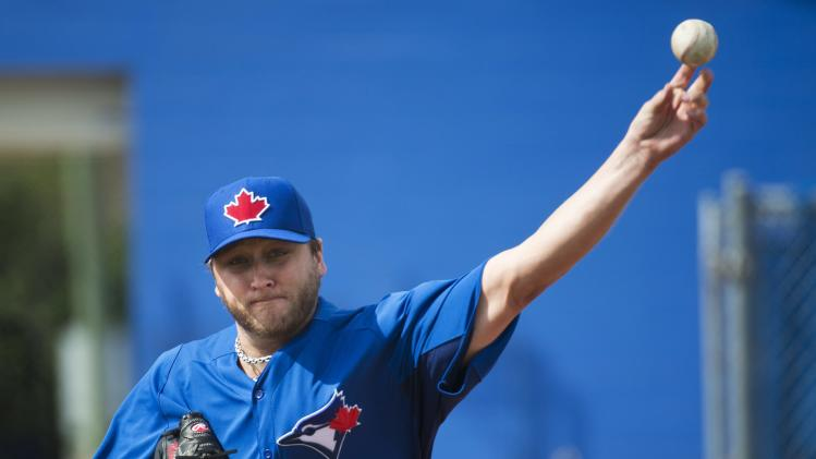 Toronto Blue Jays starting pitcher Mark Buehrle throws in the bullpen during baseball spring training in Dunedin, Fla., on Wednesday, Feb. 13, 2013. (AP Photo/The Canadian Press, Nathan Denette)