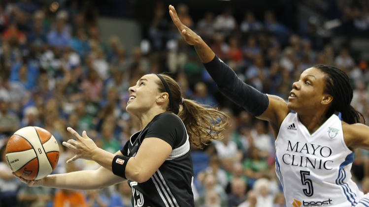 San Antonio Stars guard Becky Hammon (25) goes to the basket past Minnesota Lynx guard Tan White (5) during the second half of Game 1 of a WNBA basketball Western Conference semifinal, Thursday, Aug. 21, 2014, in Minneapolis. The Lynx won 88-84. (AP Photo/Stacy Bengs)