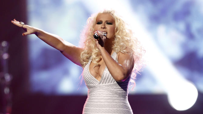 """FILE - This Nov. 20, 2011 file photo shows Christina Aguilera performing at the 39th Annual American Music Awards in Los Angeles. Aguilera is comparing her upcoming album to a """"rebirth."""" With more than a decade in the music business behind her, the album will be a culmination of """"everything I've experienced up until this point,"""" the pop star said, including divorce. The album doesn't have a release date and the title hasn't been announced. Aguilera, a coach on NBC's singing contest, """"The Voice,"""" will perform the first single, """"Your Body,"""" on the show on Sept. 17. (AP Photo/Matt Sayles, file)"""