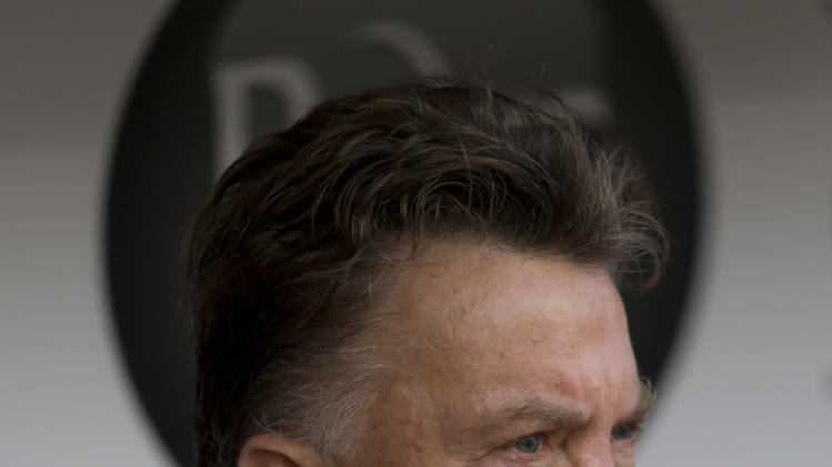 Manchester United's manager Louis van Gaal takes his seat before his team's English Premier League soccer match against Burnley at Turf Moor Stadium, Burnley, England, Saturday Aug. 30, 2014. (AP Photo/Jon Super)