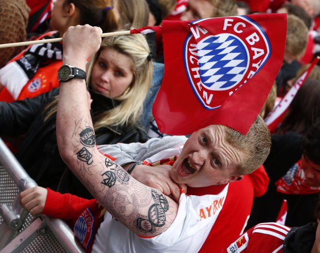 File photo of Bayern Munich supporter showing his tattoos while waiting for Bayern team with German soccer championship trophy during reception at Munich's townhall