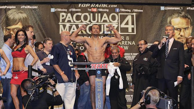 Juan Manuel Marquez weighs in for his welterweight boxing match against Manny Pacquiao, Friday, Dec. 7, 2012, in Las Vegas. Marquez and Pacquiao are scheduled to face off in their fourth fight on Saturday. (AP Photo/Julie Jacobson)