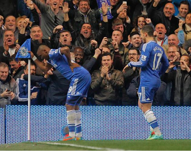 Chelsea's striker Samuel Eto'o (L) celebrates scoring a goal during an English Premier League football match against Tottenham Hotspur at Stamford Bridge in London on March 8, 2014