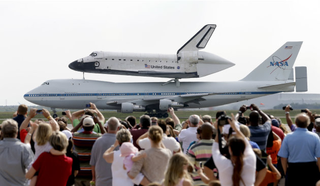 Space shuttle Endeavour sits atop NASA's Shuttle Carrier Aircraft, or SCA, Wednesday, Sept. 19, 2012, at Ellington Field in Houston. Endeavour is making a final trek across the country to the Californ