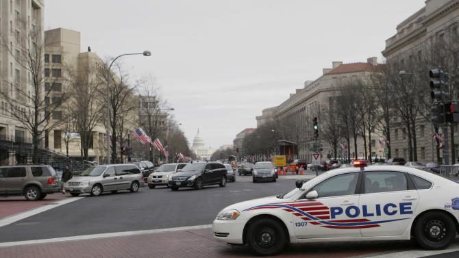 FILE - This Jan. 17, 2009 file photo shows traffic redirected from Pennsylvania Ave. in downtown Washington, with the Capitol in the background. From a transportation perspective, Inauguration Day won't be all that different from most regular workdays in the nation's capital: If you want to get downtown on time, you're probably better off not driving. Instead, the hundreds of thousands of people spilling into the city are encouraged to travel by rail, bus or bicycle. And no matter what they choose, they'll eventually end up on foot _ and possibly walking several miles _ to catch a glimpse of President Barack Obama.  (AP Photo/Lawrence Jackson, File)
