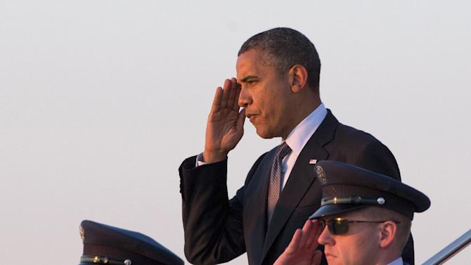 President Barack Obama salutes as he steps off of Air Force One, Thursday, Sept. 13, 2012, at Andrews Air Force Base, Md. (AP Photo/Carolyn Kaster)
