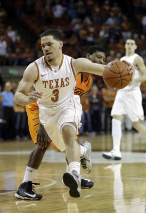 Texas PG Felix has hip surgery