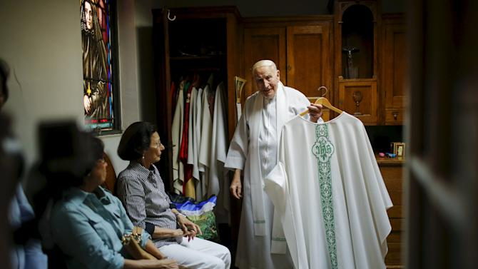 Father Bartholomew Daly hangs his garment after giving the last mass at the Church of Our Lady of Peace in New York