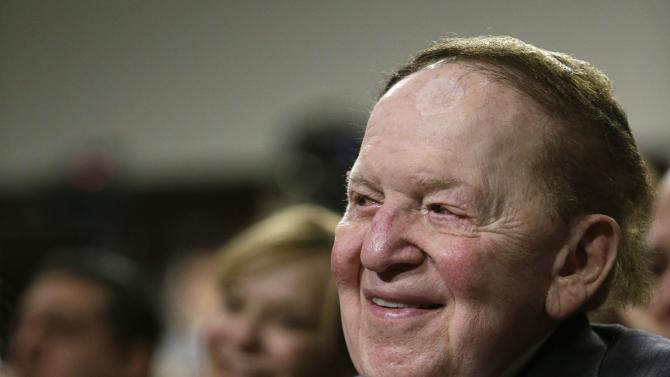 Adelson listens to Nobel Peace Laureate Wiesel at a roundtable discussion on Capitol Hill in Washington