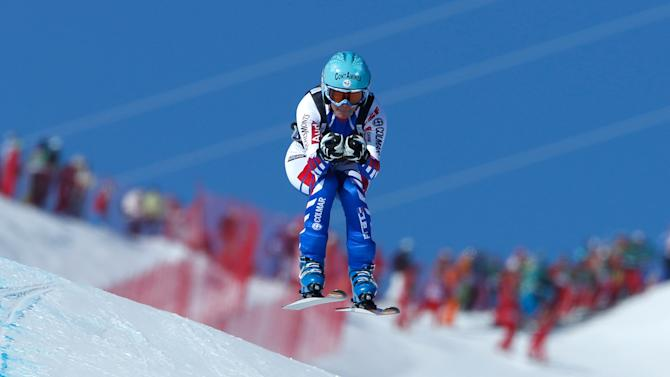 France's Marie Marchand-Arvier speeds down the course on her way to placing third in an alpine ski World Cup women's downhill race, in Meribel, France, Saturday, Feb. 23, 2013. (AP Photo/Marco Trovati)