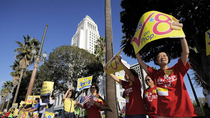 FILE - This Nov. 2, 2008 file photo shows supporters of Proposition 8, the state's measure that banned same sex marriages, in front of city hall during a Yes on Prop. 8 rally in Los Angeles. The U.S. Supreme Court is expected to issue a ruling that will determine the fate of California's voter-approved ban on same-sex marriages on Wednesday morning, June 26, 2013. (AP Photo/Mark J. Terrill, File)