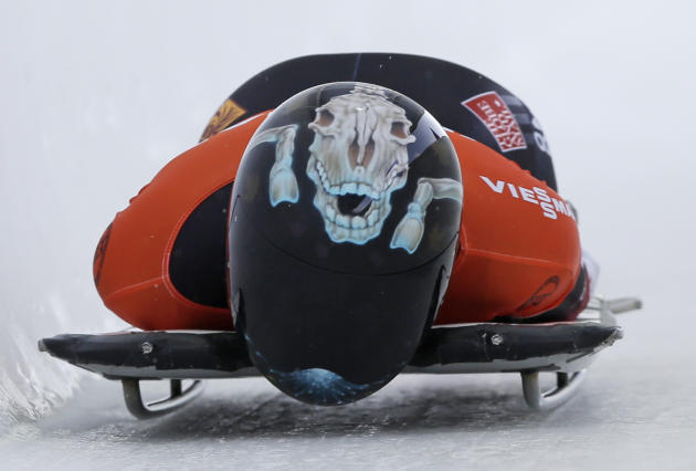 Canada's Mellisa Hollingsworth competes in the women's skeleton World Cup event on Friday, Dec. 13, 2013, in Lake Placid, N.Y
