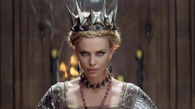 """This film image released by Universal Pictures shows Charlize Theron in a scene from """"Snow White and the Huntsman"""". (AP Photo/Universal Pictures)"""