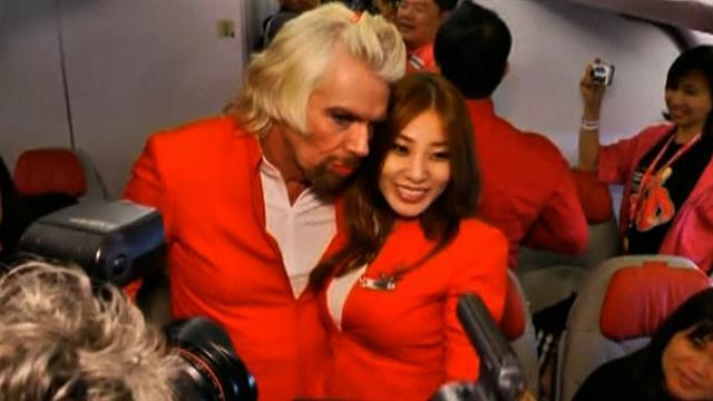Richard Branson does drag on flight