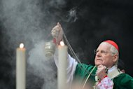 Cardinal Angelo Scola celebrates a mass on February 12, 2013 in Milan&#39;s Duomo cathedral. As the Catholic Church prepares to elect a pope, some irreverent souls are betting on the outcome while more religious-minded ones are &quot;adopting&quot; individual cardinals on a website to pray that they make the right choice