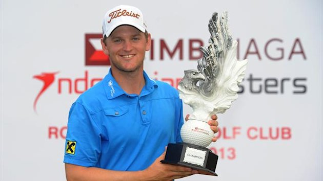 Bernd Wiesberger of Austria posing with the winner's trophy after the final round of the 750,000 USD CIMB Niaga Indonesian Masters (AFP)