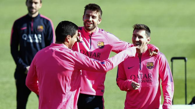 Barcelona's Suarez jokes with teammate Pique and Messi during training session at Ciutat esportiva Joan Gamper in Sant Joan Despi near Barcelona