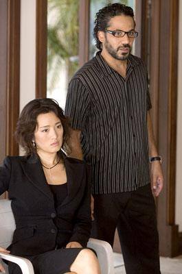 Gong Li and John Ortiz in Universal Pictures' Miami Vice