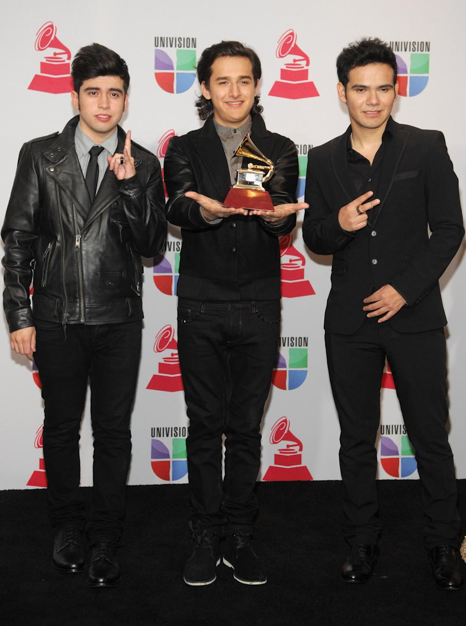 Musical group 3Ball MTY pose backstage with the best new artist award at the 13th Annual Latin Grammy Awards at Mandalay Bay on Thursday, Nov. 15, 2012, in Las Vegas. (Photo by Brenton Ho/Powers Imagery/Invision/AP)