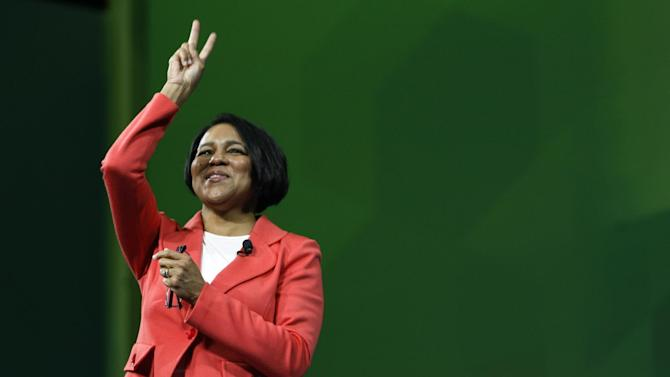 CORRECTS FIRST NAME TO ROSALIND INSTEAD OF ROZ - Sam's Club President and CEO Rosalind Brewer reacts to a crowd celebration during the Wal-Mart  shareholders meeting in Fayetteville, Ark., Friday, June 7, 2013. (AP Photo/Gareth Patterson)
