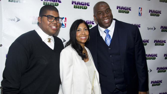 "FILE - This April 11, 2012 file photo shows Magic Johnson, right, his wife Cookie and son E.J. arriving for the opening night performance of the Broadway play ""Magic/Bird"" in New York. The 20-year-old son of basketball great Magic Johnson is surprised by the public interest in his being gay, something that he revealed to his supportive family several years ago. Earvin Johnson III, known as E.J., says he feels like he's coming out of the closet a second time and that he's ""reveling"" in the experience _ even though news of his sexual orientation broke publicly sooner than he had planned. (AP Photo/Charles Sykes, File)"