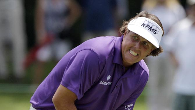 Phil Mickelson reacts to missing a putt on the third hole during the first round of the Memorial golf tournament Thursday, May 31, 2012, in Dublin, Ohio.  (AP Photo/Jay LaPrete)
