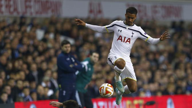 Tottenham Hotspur's Naughton evades a tackle from Partizan Belgrade's Volkov during their Europa League soccer match at White Hart Lane in London