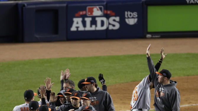 The Baltimore Orioles celebrate after beating the New York Yankees 2-1 in 13 innings in Game 4 of the American League division baseball series Thursday, Oct. 11, 2012, in New York. (AP Photo/Peter Morgan)