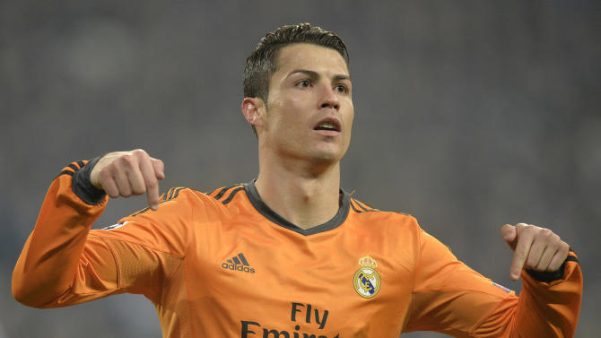 Real's Cristiano Ronaldo reacts after scoring during a Champions League round of sixteen, first leg soccer match between Schalke 04 and Real Madrid at the Veltins Arena in Gelsenkirchen, Germany, Wednesday Feb. 26, 2014. (AP Photo/Martin Meissner)