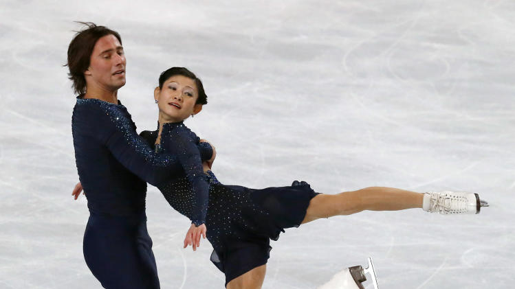 Alexander Smirnov, left, and Yuko Kavaguti, right, of Russia, perform in the pairs free skating at the ISU Figure Skating Eric Bompard Trophy, at Bercy arena in Paris, Saturday, Nov. 17, 2012. (AP Photo/Michel Euler)