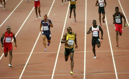 Bolt secures third world sprint sweep as Jamaica win relay