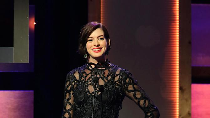 Anne Hathaway seen at the 28th Annual American Cinematheque Awards Honoring Matthew McConaughey held at The Beverly Hilton on Tuesday, Oct 21, 2014, in Beverly Hills. (Photo by Eric Charbonneau/Invision for American Cinematheque/AP Images)