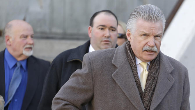 Will County State's Attorney James Glasgow, right, and members of his prosecution team leave the Will County Courthouse for lunch, Wednesday, Feb. 20, 2013, in Joliet, Ill., during the second day of a hearing in Drew Peterson's request for a new trial. Retired judge Daniel Locallo testified Wednesday as the defense sought to bolster arguments Peterson deserved a retrial on charges he murdered his third wife, Kathleen Savio. Peterson's attorneys contend his former lead trial attorney, Joel Brodsky, botched his case. Locallo told the judge that Brodsky made a major mistake by calling one witness whose testimony badly backfired on the defense. (AP Photo/M. Spencer Green)