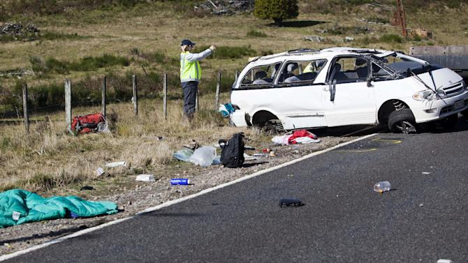 FILE - In this Saturday, May 12, 2012 file photo, police officers examine the scene of a minivan crash near Turangi, New Zealand. Three Boston University students were killed and Meg Theriault, of Salisbury, Mass., and others were injured in the single-vehicle accident. (AP Photo/New Zealand Herald, John Cowpland, File)