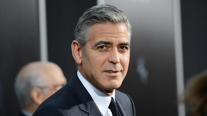 "FILE - In this Oct. 1, 2013 file photo actor George Clooney attends the premiere of ""Gravity"" at the AMC Lincoln Square Theaters, in New York. George Clooney has chastised a British newspaper over an article claiming his fiancee's mother disapproves of the impending marriage for religious reasons. Clooney said that the claims about his future mother-in-law Baria Alamuddin were untrue and irresponsible. (Photo by Evan Agostini/Invision/AP, File)"