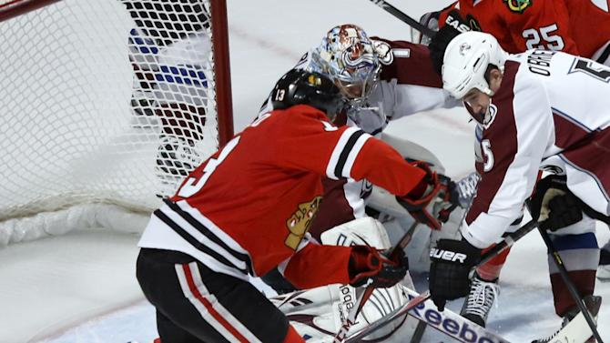 Chicago Blackhawks left wing Daniel Carcillo, left, shoots and scores the winning goal past Colorado Avalanche defenseman Shane O'Brien (5) and goalie Semyon Varlamov, of Russia, with under a minute left in the third period of an NHL hockey game, Wednesday, March 6, 2013, in Chicago. The Blackhawks won 3-2. (AP Photo/Charles Rex Arbogast)