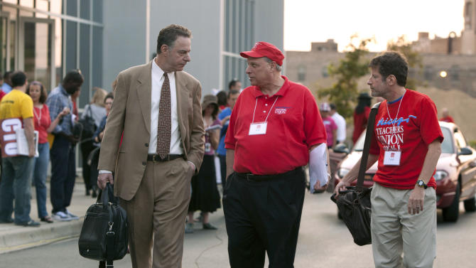 Chicago Teachers Union lawyer Robert Bloch, left, talks to CTU delegates following a meeting Sunday, Sept. 16, 2012 in Chicago. The Chicago teachers union decided to continue its weeklong strike, extending an acrimonious standoff with Mayor Rahm Emanuel over teacher evaluations and job security provisions central to the debate over the future of public education across the United States. (AP Photo/Sitthixay Ditthavong)
