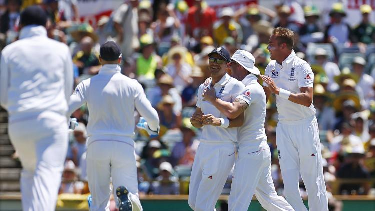 England's players congratulate teammate Anderson after he ran out Australia's Rogers during the first day's play of the third Ashes cricket test match at the WACA in Perth
