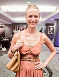 Model Julie Henderson at the Leisure Retreat Lounge during Miami Swim Week wearing simple accessories.