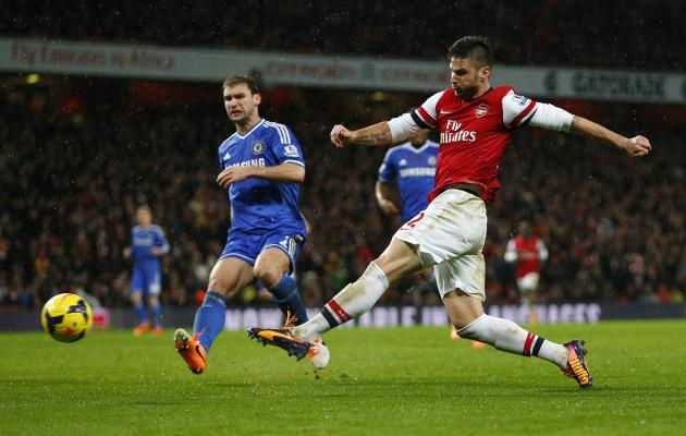 Arsenal's Giroud shoots at goal as Chelsea's Ivanovic looks on during their English Premier League soccer match at The Emirates in London
