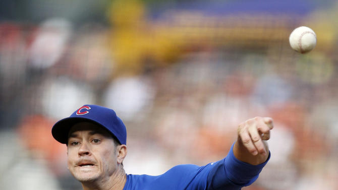 Chicago Cubs starting pitcher Chris Rusin throws to the San Francisco Giants during the first inning of a baseball game on Saturday, July 27, 2013, in San Francisco. (AP Photo/Tony Avelar)