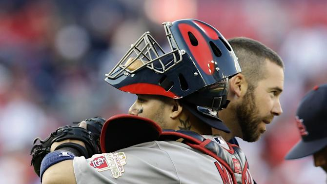 St. Louis Cardinals starting pitcher Chris Carpenter, back, hugs catcher Yadier Molina after Game 3 of the National League division baseball series against the Washington Nationals, Wednesday, Oct. 10, 2012, in Washington. St. Louis won 8-0. (AP Photo/Alex Brandon)