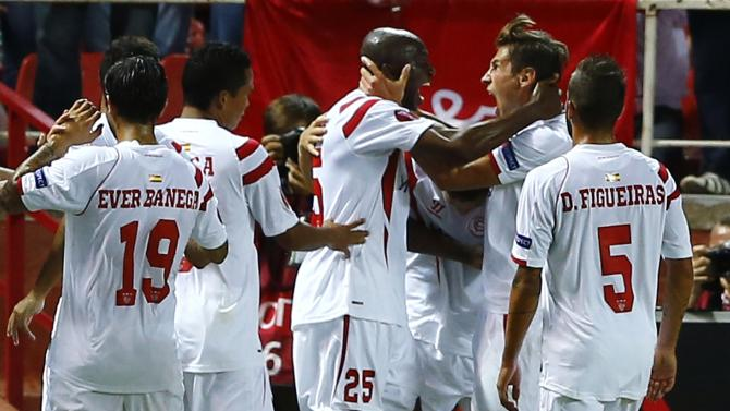 Sevilla's Stephane Mbia is congratulated by Sevilla's Grzegorz Krychowiak after scoring against Feyenoord Rotterdam during their soccer match in Seville