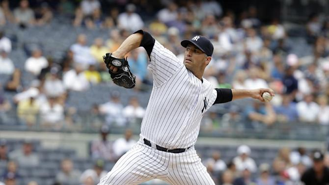New York Yankees starting pitcher Andy Pettitte pitches during the first inning of a baseball game against the Kansas City Royals at Yankee Stadium Thursday, July 11, 2013 in New York. (AP Photo/Seth Wenig)